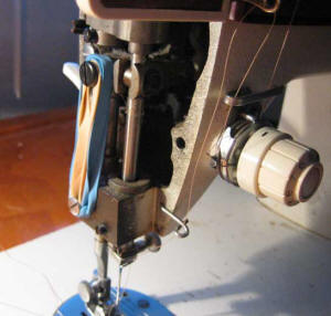 old Singer Merritt sewing machine with rubber bands on it